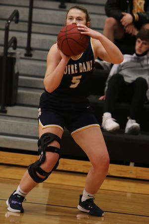Notre Dame High School's Megan Harrell (5) prepares to shoot the ball during the first half of their game against New London High School, Tuesday Jan. 5, 2021 at New London.