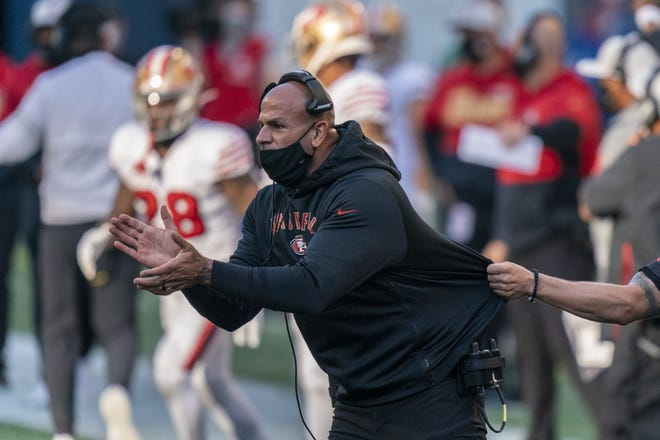 FILE - In this Nov. 1, 2020, file photo, San Francisco 49ers defensive coordinator Robert Saleh cheers on his team from the sideline during the first half of an NFL football game against the Seattle Seahawks in Seattle. AP Photo/Stephen Brashear