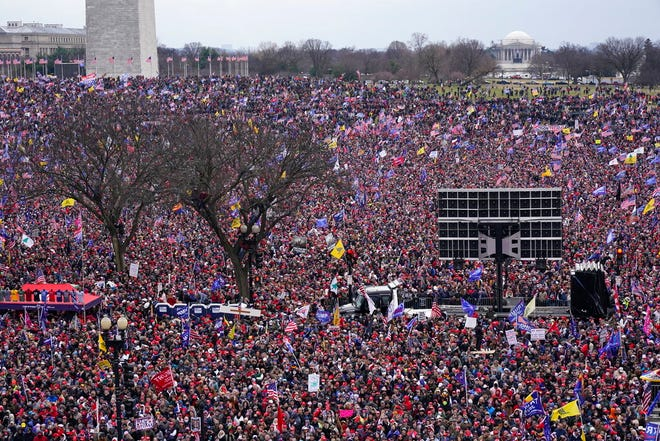 With the Washington Monument in the background, thousands of people attend a rally in support of President Donald Trump near the White House on Wednesday in Washington. (AP Photo/Jacquelyn Martin)