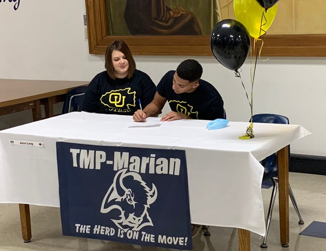 TMP-Marian's Jace Lang signs his letter of intent to play football at Ottawa University on Wednesday at TMP-Marian.