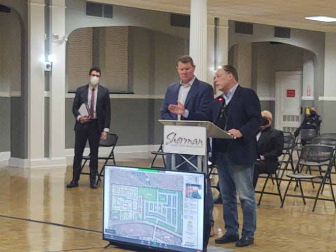 Robert Colombo and Bryan Garcia speak Monday night on behalf of a proposed new hospital  that could be built in south Sherman. The city council voted to approve a series of agreements supporting the pre-development of the project.