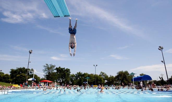 A Salt City Splash patron dives into the city pool in this April 2013 file photo.