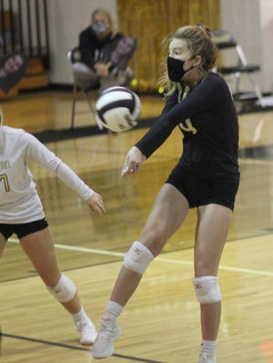 Croatan's Molly Butler receives the ball during the Cougars' Dixon 25-17, 25-6, 25-6 win over Dixon in a Coastal 8 1-A/2-A Conference volleyball match Tuesday night. [Chris Miller / The Daily News]