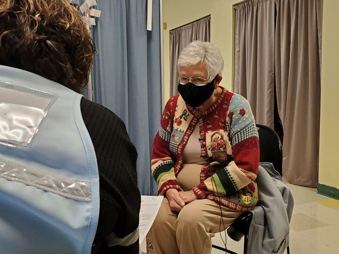 Onslow County resident Jane Swint was one of the first recipients age 75 or older to receive the COVID-19 vaccination at the Onslow County Multipurpose Complex early Wednesday morning.