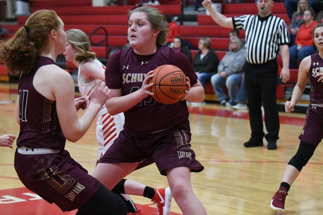 Schuyler County's Kait Hatfield comes down with a defensive rebound Tuesday against La Plata.