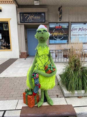 Harps & Thistles Yarn & Gift Emporium's Grinch decoration was the winner in three out of four categories in the city of Cuyahoga Falls' first ever Parking Meters on Parade contest.