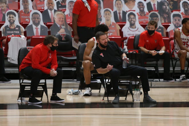 Jan 5, 2021; Lubbock, Texas, USA;  Texas Tech Red Raiders head coach Chris Beard and assistant coach Mark Adams on the bench during the game against the Kansas State Wildcats at United Supermarkets Arena. Mandatory Credit: Michael C. Johnson-USA TODAY Sports