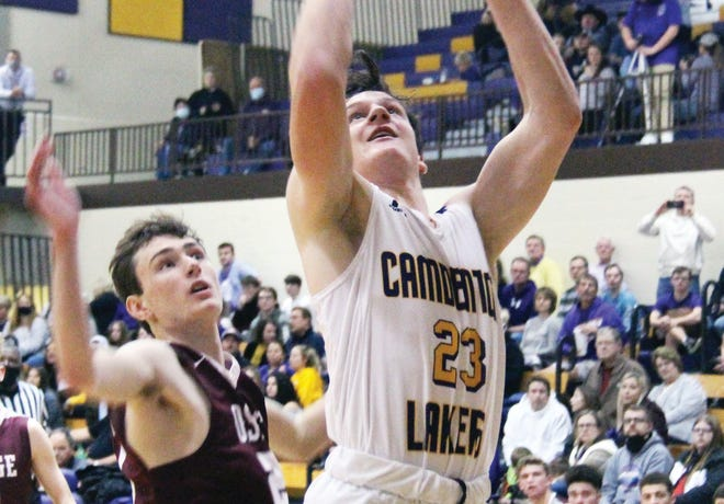 Camdenton sophomore Kam Durnin (23) goes up for a layup past Osage junior Alton Drace on Tuesday, January 5, in Camdenton. Durnin led the Lakers with 14 points in the win over the Indians.