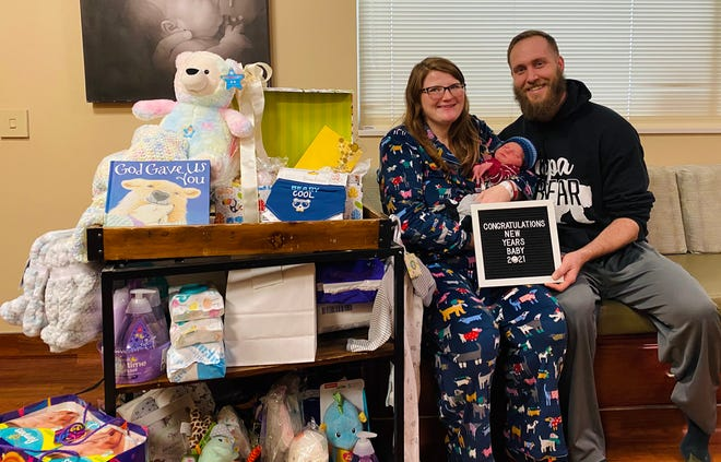 Laramee Wright and Cory Smith of Macomb, Illinois welcomed the first baby of 2021 at Memorial Hospital in Carthage, Illinois. Marshall Ezra Smith was born on Monday, January 4th at 3:49 p.m. Marshall weighed 8 pounds and 5.7 ounces. He was 21.5 inches long. Left to right: Laramee Wright, Cory Smith and baby Marshall