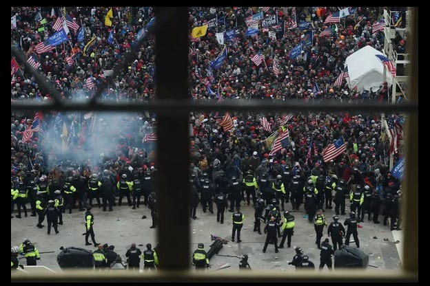 Police hold back supporters of US President Donald Trump as they gather outside the US Capitol's Rotunda on January 6, 2021, in Washington, DC. - Demonstrators breeched security and entered the Capitol as Congress debated the a 2020 presidential election Electoral Vote Certification.