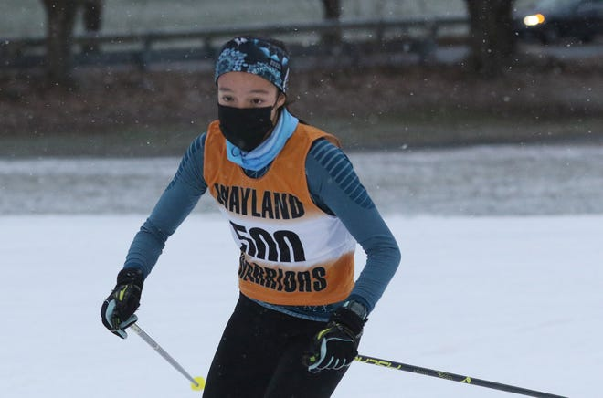 Wayland's Tali Wong turned the corner on her first lap of the Mass Bay West cross country ski race was held at the Weston Ski Track, Jan. 5, 2021.