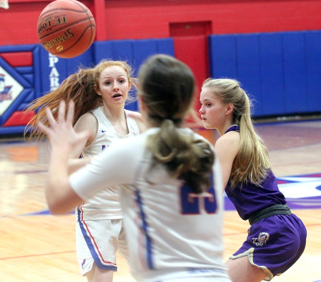 Moberly freshman Haley Baker tosses the basketball toward the low post reaching sophomore teammate Kennedy Messer (#23) during Tuesday's home game. The Lady Spartans dropped a 65-47 home decision to Hallsville.