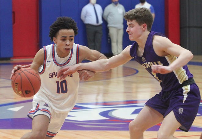 Moberly Spartans junior point guard Jaisten Payne attempts to drive the lane Tuesday while being defended by Hallsville's Jalen George. Payne scored a game-high 20 points, but the Spartans suffered a 54-48 home loss to the Indians.