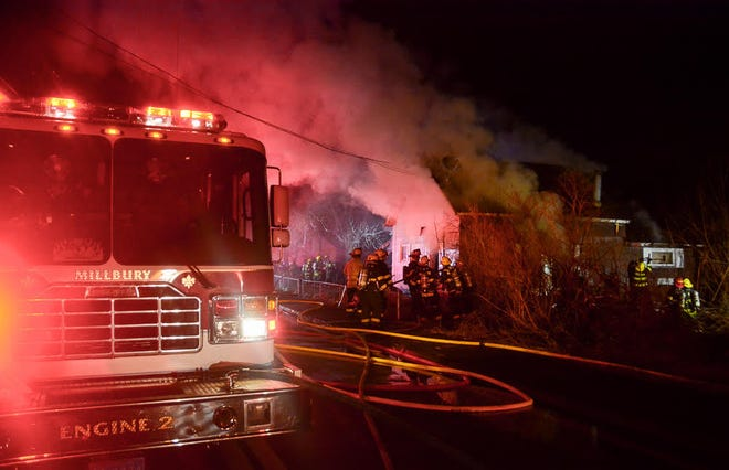 A house on Sutton Road in Millbury was heavily damaged by fire Monday evening, Dec. 28, 2020.