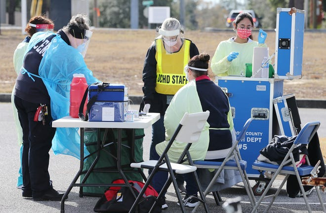 The Okaloosa County Health Department set up a drive-up COVID-19 vaccination site at Northwest Florida State College.