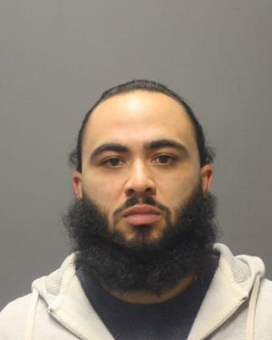 Jamir Castillo, 29, of Boston is accused of driving around with pounds of marijuana and a gun in his car.