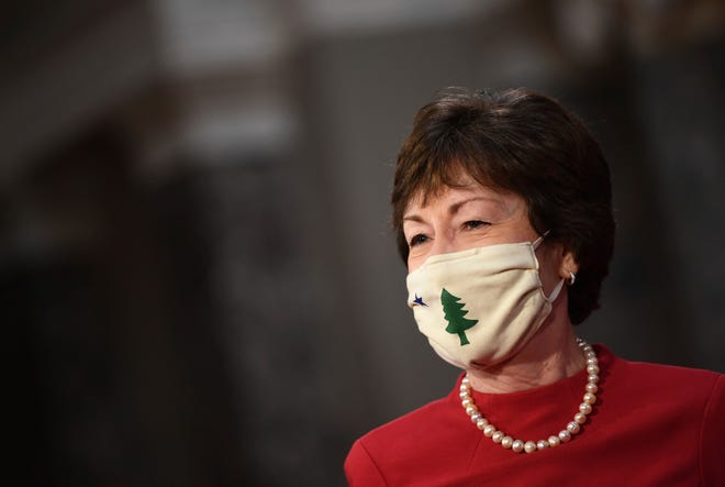 Sen. Susan Collins, R-Maine, wears a face mask as Vice President Mike Pence, not pictured, administers the oath of office during a reenactment ceremony in the Old Senate Chamber at the Capitol in Washington, Sunday, Jan. 3, 2021.