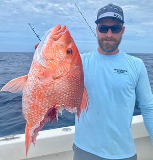 Evidence of shark depredation on a red snapper. PATRICK PRICE / DAYMAKER FISHING