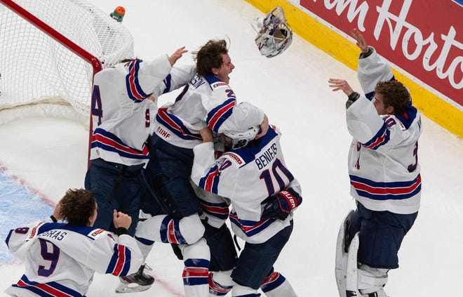 U.S. players celebrate their win over Canada on Tuesday in the championship game in the IIHF World Junior Hockey Championship in Edmonton, Alberta. [The Canadian Press via AP / Jason Franson]