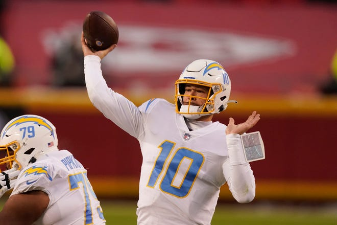 Los Angeles Chargers quarterback Justin Herbert threw for three touchdowns and ran for another in Sunday's 38-21 win over the Kansas City Chiefs.
