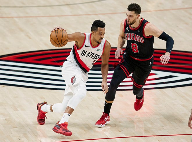 Portland's CJ McCollum, who had 26 points, drives on Chicago's Zach LaVine (8) during the first half of Tuesday's game in Portland. Chicago won 111-108.