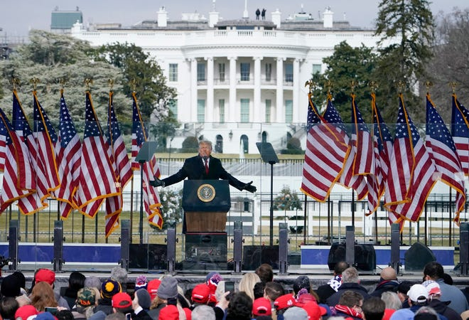 With the White House in the background, President Donald Trump speaks at a rally Wednesday, Jan. 6, 2021, in Washington.