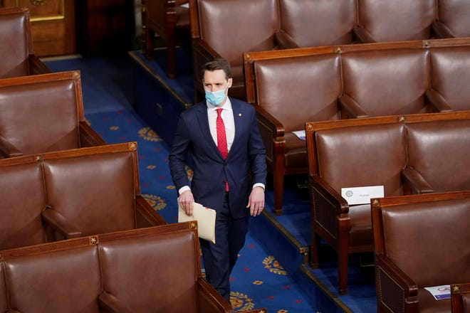 Sen. Josh Hawley, R-Mo., walks into the House chamber before a joint session of the House and Senate.