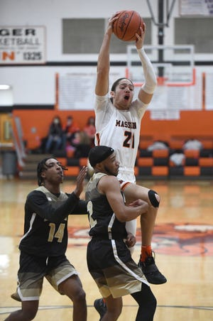 Massillon's Jayden Ballard goes up for a shot against St. Thomas Aquinas on Tuesday.  (IndeOnline.com / Kevin Whitlock)