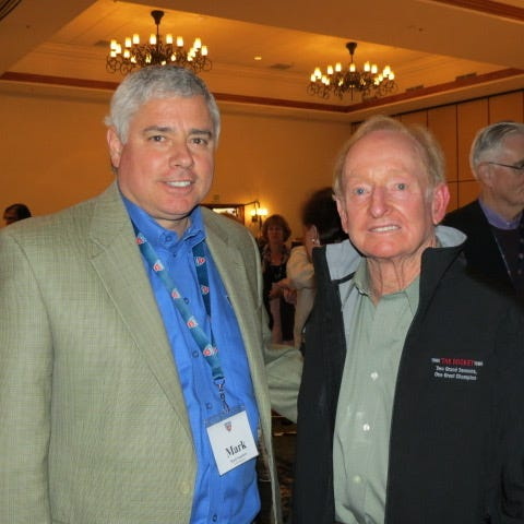 Rockford native Mark Saunders, the executive director of the United States Tennis Association Midwest Section, left, poses with Rod Laver, who has won a record 200 men's singles titles and is the only man to sweep all four Grand Slam events in the Open Era.