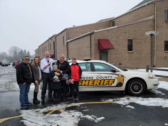 The family of Boone County Sheriff's Deputy Scott Bowers presented a $2,000 check to Sheriff Dave Ernest (back row center) on Tuesday, Jan. 5, 2021 to help the department acquire and train a new K-9 officer.