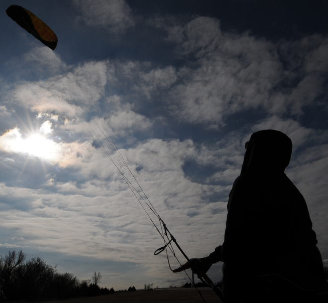 Salina native Gage Kerns practices flying his father's 6-meter foil kite, with the wind gusting up to 16 mph from the north, at the Berkley Family Recreational Area in Salina on Wednesday.
