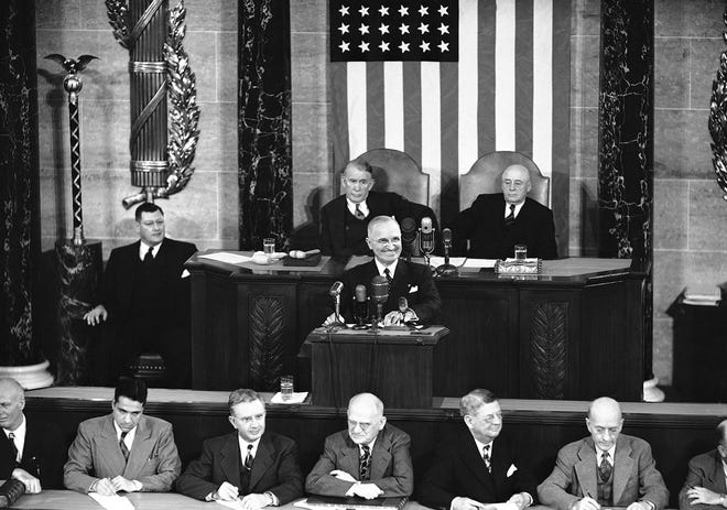 """President Harry Truman was unusually grim as he addressed Congress in Washington on Jan. 8, 1951, but he did grin as Republicans responded with yells when he called for """"rigid economy"""" in non-defense spending."""