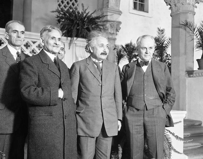 In this distinguished group which met in Pasadena, Calif., on Jan. 10, 1931, to discuss scientific problems are, left to right: Walter S. Adams, astronomer and director of the Mt. Wilson Carnegie observatory; Dr. Albert A. Michelson, formerly of Chicago University, who measured the speed of light; Dr. Albert Einstein, famed for his theory of relativity; and Dr. Robert A. Millikan, president of the California Institute and discoverer of the cosmic ray. The latter three have been awarded the Nobel Prize.