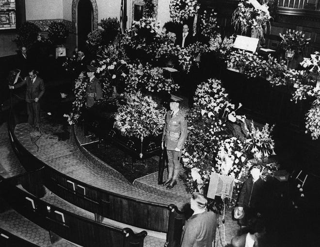 The body of Calvin Coolidge lay in state one hour in the Edwards Congregational Church, Northampton, Mass., on Jan. 7, 1933, before it was taken in its last, long trek to the homely surroundings of his birthplace in Plymouth, Vermont, for burial. Guard of honor stands beside the casket just before the crowd was admitted to the church.