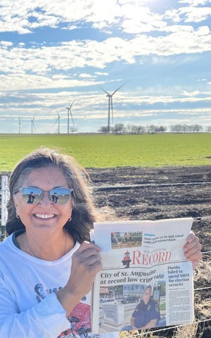 Victoria Webb showing off The Record in front of windmills and cattle in Cooke County, Texas. Her Thanksgiving visit to the family's OO Ranch was double blessed with the birth of her grandson, Colin.