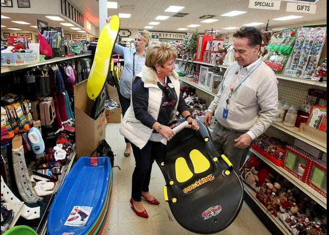 In this file photo, Don Thrower, right, assists Penny Galop, center and Sandy Bishop as they look at some of the sleds available at Medical Center Pharmacy in Gastonia.