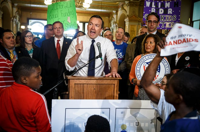 Illinois state Sen. Andy Manar, D-Bunker Hill, speaks during a rally for education funding and a bill that would change the school funding formula at the state Capitol on May 26, 2016. Justin L. Fowler/The State Journal-Register