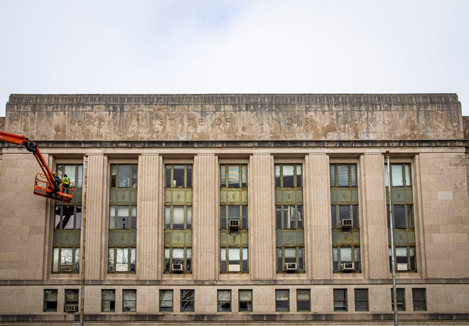 """A crew inspects the exterior windows of the Illinois State Armory as the inspection process begins for the possible renovation of structure that was built in 1936, Wednesday, January 6, 2021, in Springfield, Ill. A total of $122 million was included in the $45 billion capital plan in 2019 for """"renovation of the Armory, and other capital improvements"""" that would allow the state to return the Armory to a useable space. [Justin L. Fowler/The State Journal-Register]"""