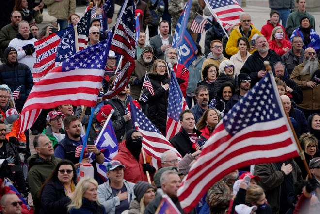 Trump supporters rally at the state Capitol, Wednesday, Jan. 6, 2021, in Oklahoma City. (AP Photo/Sue Ogrocki)