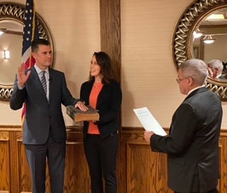 New 37th Dist. Senator Win Soller is sworn in Tuesday by Circuit Judge Stephen Kouri.