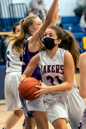 Apponequet's Abi Lens drives to the basket during a 32-25 season opening win over Bourne on Tuesday night.