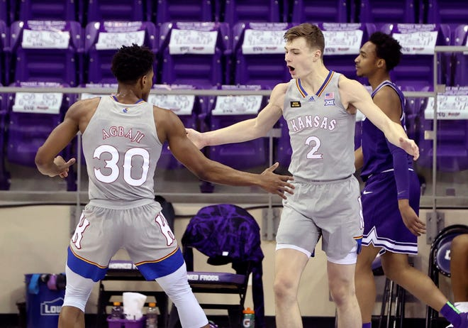Kansas basketball guards Christian Braun, right, and Ochai Agbaji celebrate during Tuesday's game against TCU in Fort Worth, Texas. The No. 6-ranked Jayhawks scored 49 points in the first half en route to a 93-64 victory over the Horned Frogs.