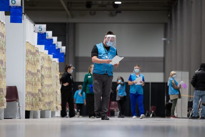 Stormont Vail Health staff help facilitate vaccine distribution in December at Stormont Vail Events Center. The health system has not distributed any doses in recent days due to short supply. (December file photo/The Capital-Journal)