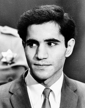 Sirhan Sirhan glances toward the courtroom as he arrives for the opening session of his murder trial in Los Angeles Jan. 7, 1969. Sirhan is the convicted assassin of Sen. Robert F. Kennedy.