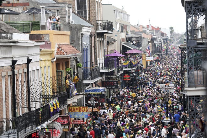 In this Feb. 25, 2020, file photo, Bourbon Street is a sea of humanity on Mardi Gras day in New Orleans.