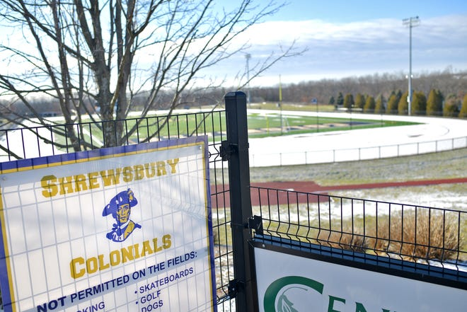 The Colonials logo is depicted on a sign upon a fence near the Shrewsbury High School playing fields.