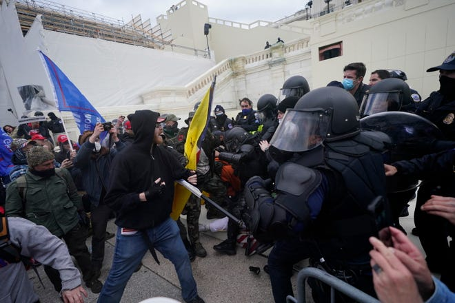A mob tries to break through a police barrier during Wednesday's riots at the U.S. Capitol in Washington.