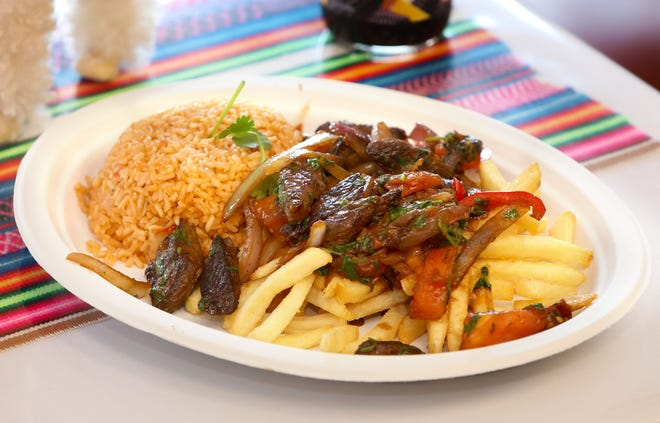 The dish Lomo Saltado, which is seasoned steak with red onions and tomatoes on a bed of french fries and rice, from the newly opened restaurant Latin Food Blessing in Gainesville. [Brad McClenny/The Gainesville Sun]