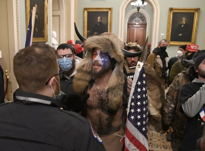 Trump supporters breached security and entered the Capitol as Congress debated the 2020 presidential election Electoral Vote Certification.