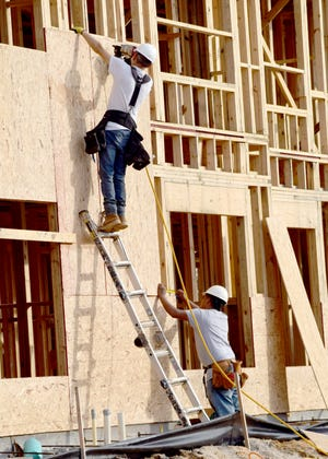 Crews work Wednesday to construct Springfield Crossings, a 60-unit apartment complex slated to open this fall in Bay County.